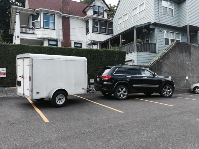 Jeep towing a cargo trailer