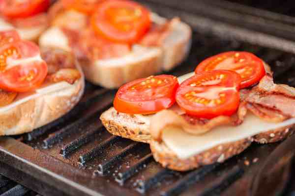 Toast with tomatoes on a plancha grill
