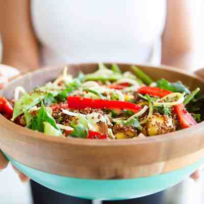 Fresh Vegetable Salad in blue and brown serving bowl