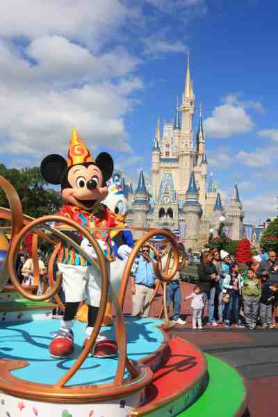 Mickey Mouse on a float in front of Cinderella's castle