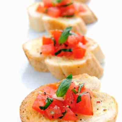 4 baguette slices topped with fresh easy bruschetta