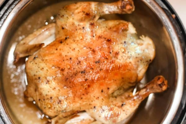 Overhead view of roasted whole chicken in an instant pot