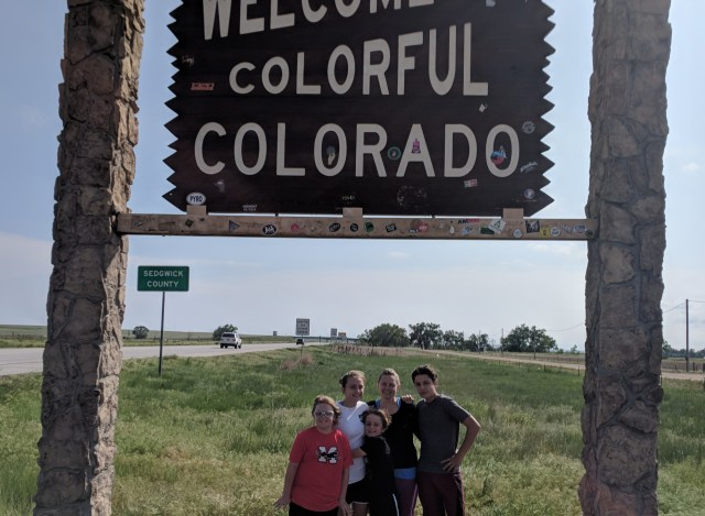 My Family Under the Welcome to Colorful Colorado Sign