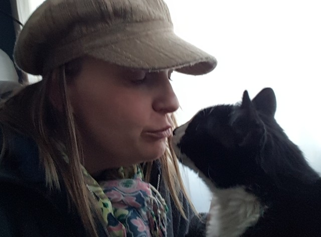 My Wife Loving on a Cat