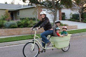 Loraine Lundquist bicycling with her family