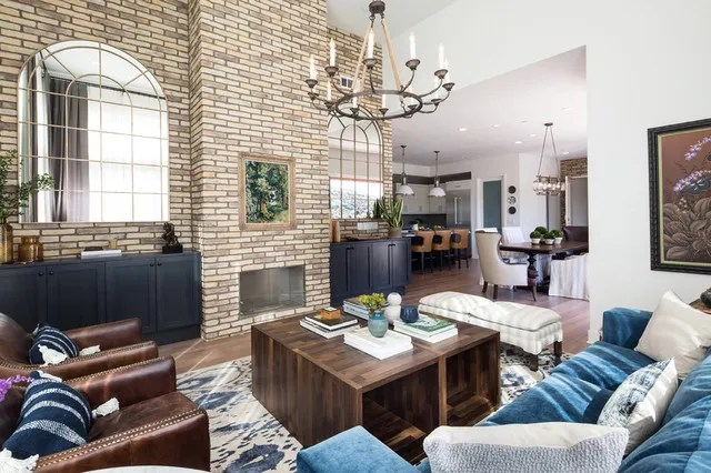 washed brick wall around fireplace industrial modern farmhouse los angeles home