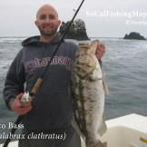 Angler holding trophy calico bass caught in the boiler rocks.