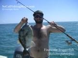 Proud angler holding triggerfish at Las Islas Encantadas in the northern Sea of Cortez.