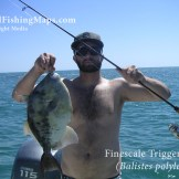Proud angler holding triggerfish at Las Islas Encantadas in the northern Sea of Cortez.
