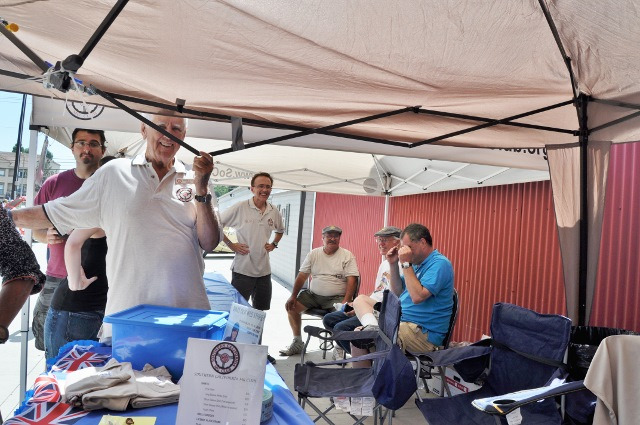 One Pop-up Tent breaks at 2014 Boots and Bonnets Car Show at ADM