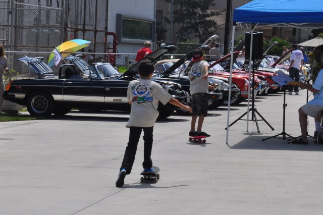 Youths at play at the 2014 Boots and Bonnets Car Show at ADM