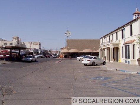 The southern end of US 99 at the Mexican border. The former Customs House is to the right.