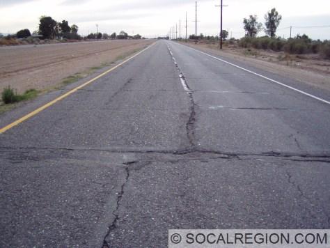 Offset concrete slabs under asphalt on old US 80 near Holtville.