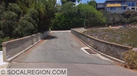 Narrow deck and railing on Crespo Drive.