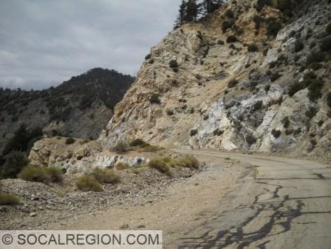 Steep slopes and crumbling rocks along Hwy 39.