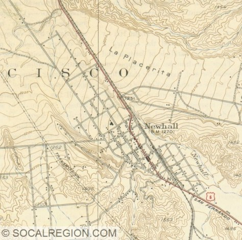 Map of Newhall from 1938. San Fernando Road makes a jog on the north end of town between 10th St (now Lyons Avenue) and 11th Street. The red line is San Fernando Road.