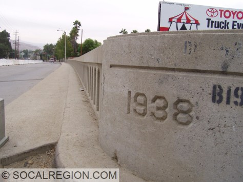 Detail of date stamp and railing. Sidewalk was added in 1968.
