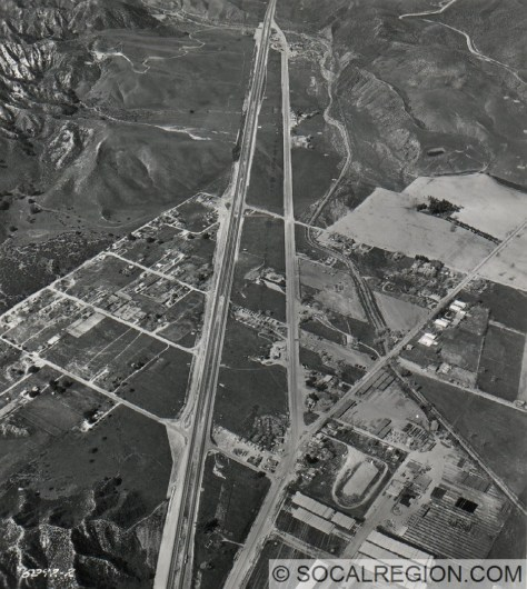 Castaic in 1958. I-5 follows the route of the divided highway on the left. The middle road is Castaic Road, the far right is the Ridge Route.