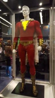 """The superhero suit on display at the DC booth for """"Shazam!""""."""