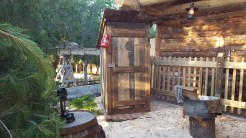 An outhouse directly outside the trading post