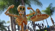 Giant skeletons in various poses throughout the area