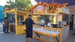 Boardwalk BBQ Booth serving up Prime Rib Sandwich, Riblets, Boysenberry Beer, Wine, Sangria, and Pumpkin Cider