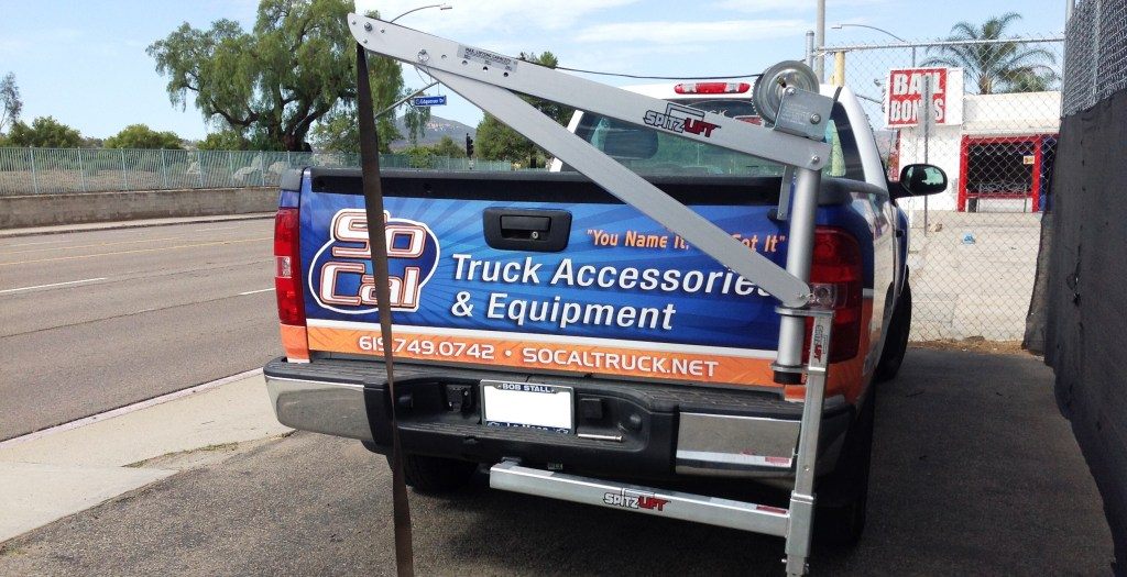 Spitzlift crane system installed on hitch mount system, but can also be installed on the truck bed.