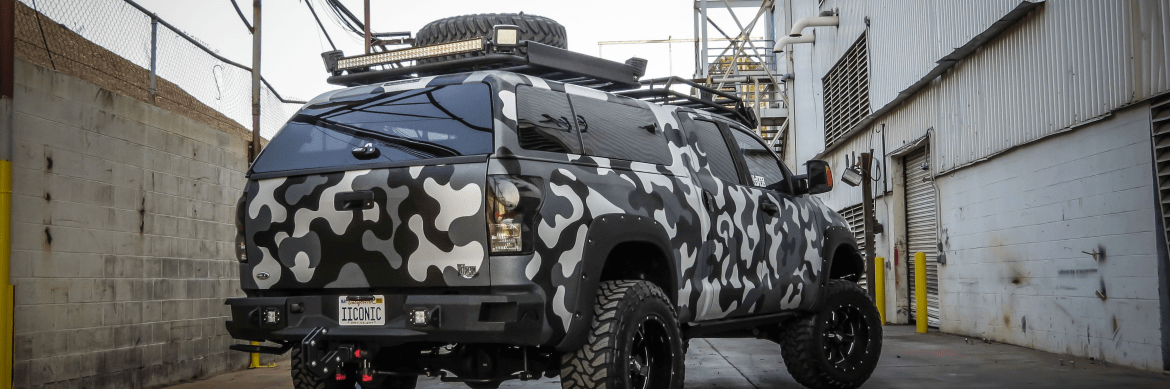 ARE Z series shown installed camouflaged wrapped truck.