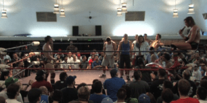 Chris Hero on the mic taking to Bryan Danielson after winning the PWG World Championship in Reseda during his final PWG match before going to WWE.