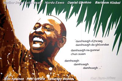 "Mural depicting Ken Saro-Wiwa in County Mayo, Ireland; some of his poetry is displayed (translated into Irish), as well as the names of the other eight activists of the ""Ogoni Nine"" that were executed. (Kilde: Wikipedia.org)"