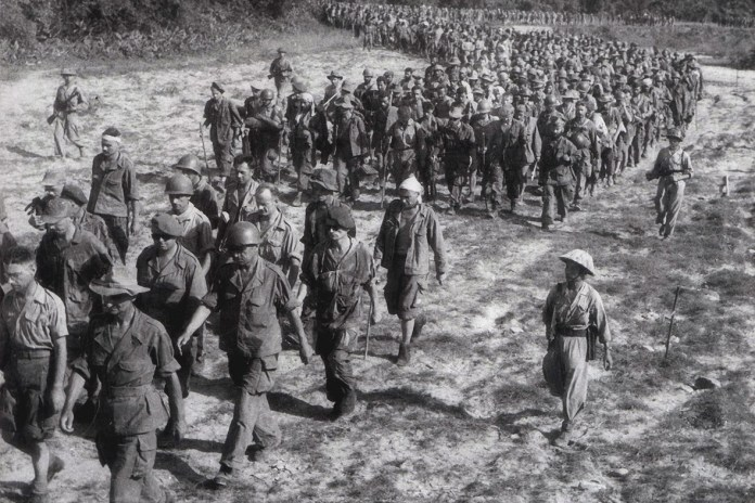Captured French soldiers, escorted by Vietnamese troops, walk to a prisoner-of-war camp in Dien Bien Phu. Source http://www.ibtimes.co.uk/vietnam-celebrates-60th-anniversary-battle-dien-bien-phu-victory-1447556 PHoto: Stringer, AFP. Public Domain.