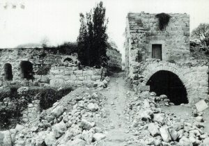 PHOTO: Ruins of homes left empty from the Deir Yassin Massacre, 1986. (Source: deiryassinremembered.org)