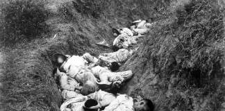 Filipino casualties on the first day of Philippine-American War. Original caption is 'Insurgent dead just as they fell in the trench near Santa Ana, February 5th. The trench was circular, and the picture shows but a small portion.' Date: 5 February 1899. By This image is a work of a U.S. Army soldier or employee, taken or made as part of that person's official duties. As a work of the U.S. federal government, the image is in the public domain. - US Archiv ARCWEB ARC Identifier: 524389, Public Domain, https://commons.wikimedia.org/w/index.php?curid=371036