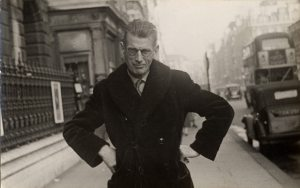 Photograph of Samuel Beckett taken by a street photographer outside Burlington House in Piccadily, ca. 1954. Photo courtesy University of Texas at Austin. Source: http://montrealrampage.com/book-of-the-month-club-the-collected-poems-of-samuel-beckett-edited-by-sean-lawlor-and-john-pilling/#prettyPhoto