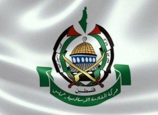 """Hamas's logo. Text: """"Der er ingen Gud foruden Allah og Mohammad er hans sendebud"""" - Og over det grønne felt: """"Palæstina"""" og i feltet: """"Den islamiske modstandsbevægelse - Hamas"""""""
