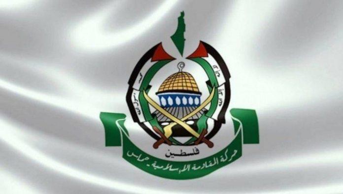 Hamas's logo. Text: