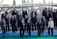 President Barack Obama, NATO Secretary General Jaap de Hoop Scheffer and fellow NATO leaders step down from a photo platform April 4, 2009, following their group photo at the NATO meeting in Strasbourg, France. 4 April 2009. Source originally posted to Flickr as P040409PS-0247 The Official White House Photostream Photo: Official White House Photo by Pete Souza