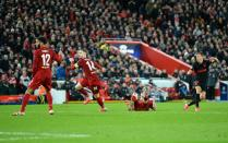 epa08287508 Marcos Llorente (R) of Atletico sores his second goal during the UEFA Champions League Round of 16, second leg match between Liverpool FC and Atletico Madrid in Liverpool, Britain, 11 March 2020. EPA-EFE/PETER POWELL