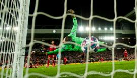 epaselect epa08287562 Marcos Llorente (L) of Atletico beats Liverpool goalkeeper Adrian to sore his second goal during the UEFA Champions League Round of 16, second leg match between Liverpool FC and Atletico Madrid in Liverpool, Britain, 11 March 2020. EPA-EFE/PETER POWELL