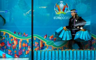 epa08289438 (FILE) - UEFA volunteer woman arranges the guests gift bags in front of a UEFA labeled banner, as seen trough the windows of the UEFA guests hotel in central Bucharest, Romania, 29 November 2019 (re-issued 12 March 2020). The UEFA announced on their website on 12 March 2020 that they have invited representatives of its 55 member associations, together with the boards of the European Club Association and the European Leagues and a representative of FIFPro, to attend meetings by videoconference on Tuesday 17 March to discuss European football's response to the coronavirus outbreak. EPA-EFE/ROBERT GHEMENT