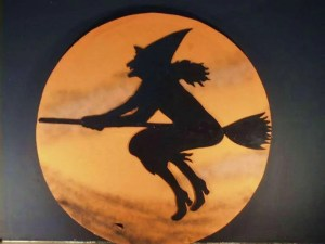 graphic of witch on broom