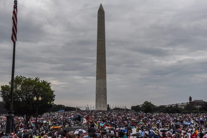 People gather on the National Mall during President Donald Trump's speech during Fourth of July festivities on 4 July, 2019