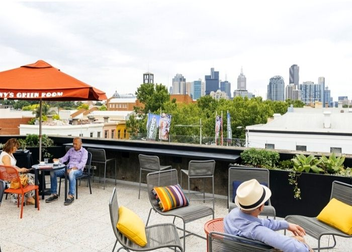 old couple seated at Johnny's green room balcony in Carlton overlooking city CBD
