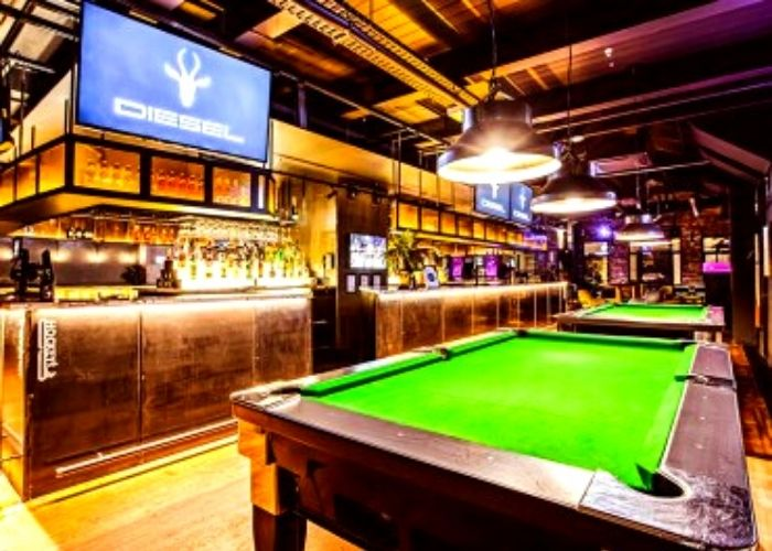 bright green pool table under down lights in diesel cbd bar and eatery on little Lonsdale street