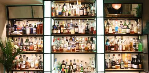 bar holding rums and spirits and vodka bottles at east china trading company