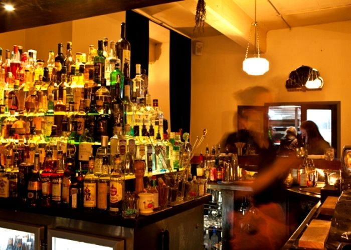 Large stack of spirits, wine and vodka in lily blacks bar on meyers place