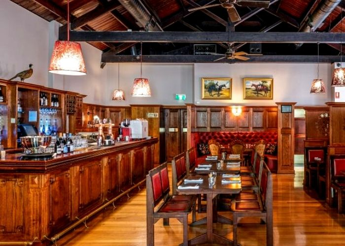 old school pub with woodern bar and table seating at saint and rogue on little collins street