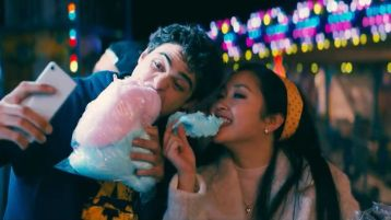 man and woman on a date while taking selfie and eating fairy floss