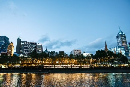 picture of arbory bar and eatery from the yarra river at night with melboure cbd in background
