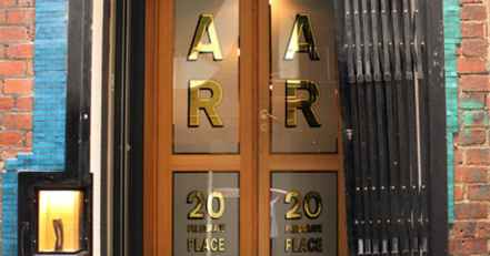 front doors of americano cocktail bar on presgrave place